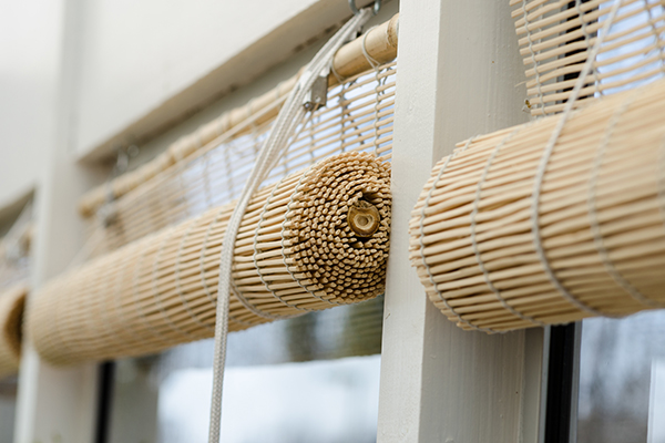 An image of some traditional roll up reed blinds
